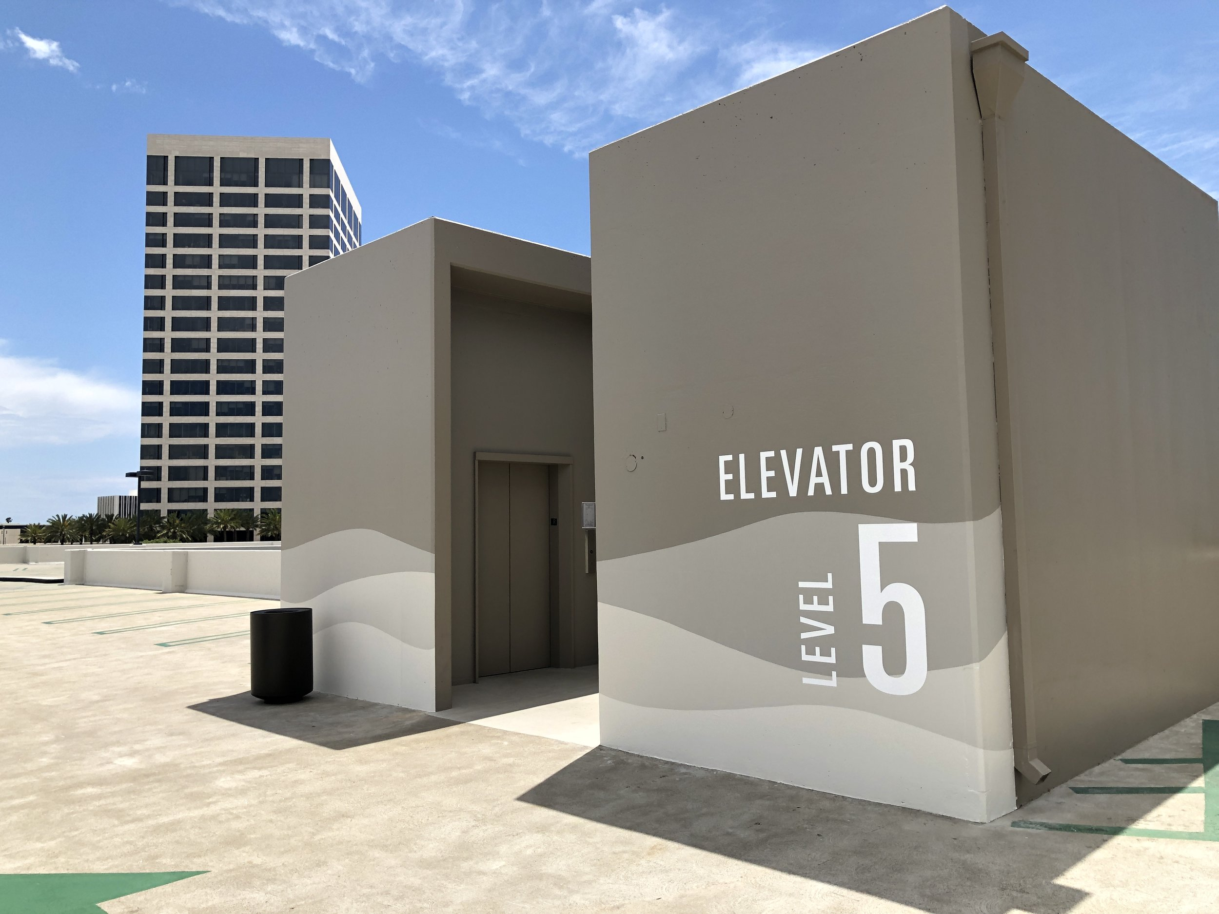 Hand painted way finding graphics parking structure Newport Beach Orange County