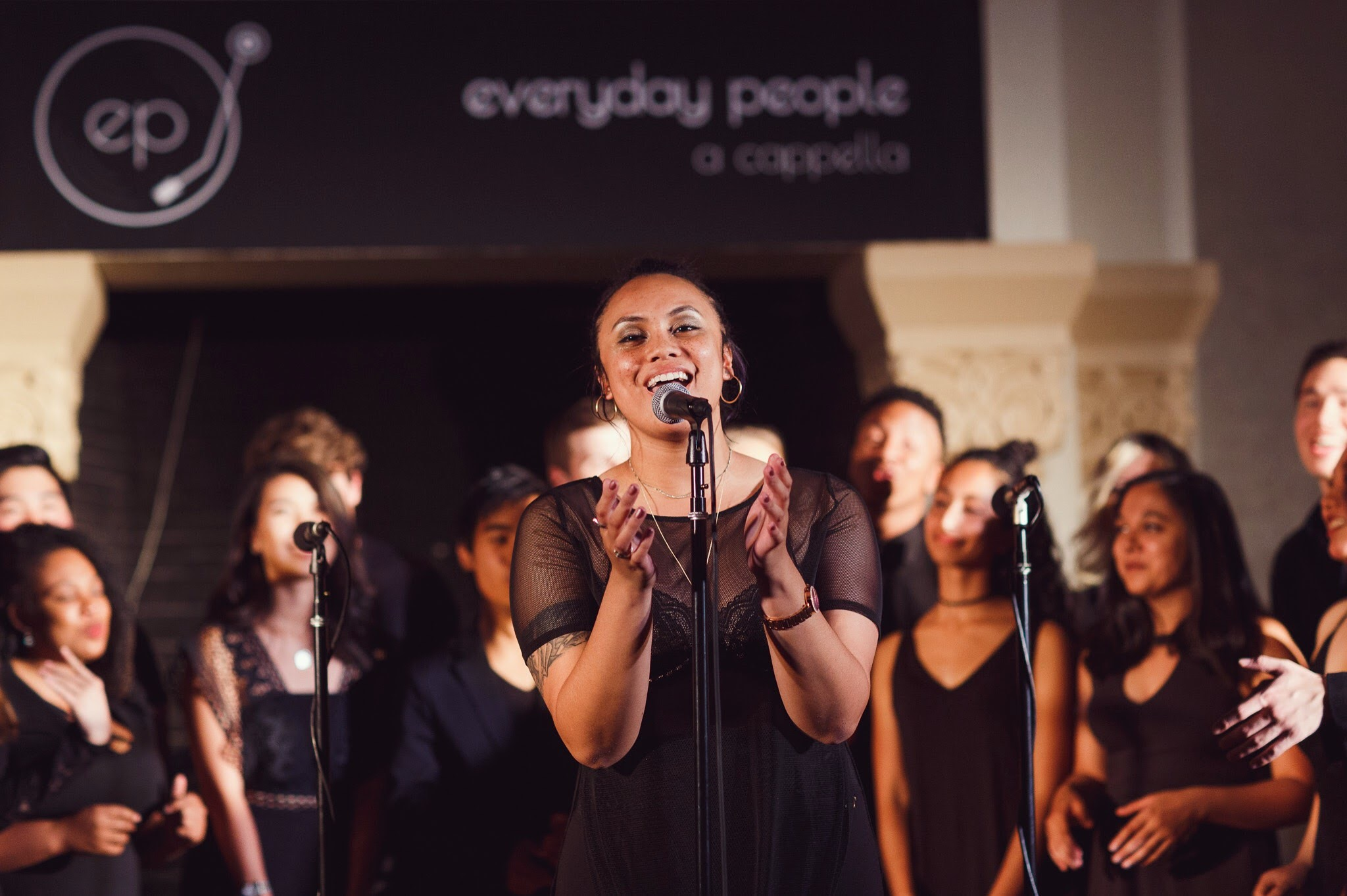 Teyonna Jarman, singing in the Stanford acapella group, Everyday People.