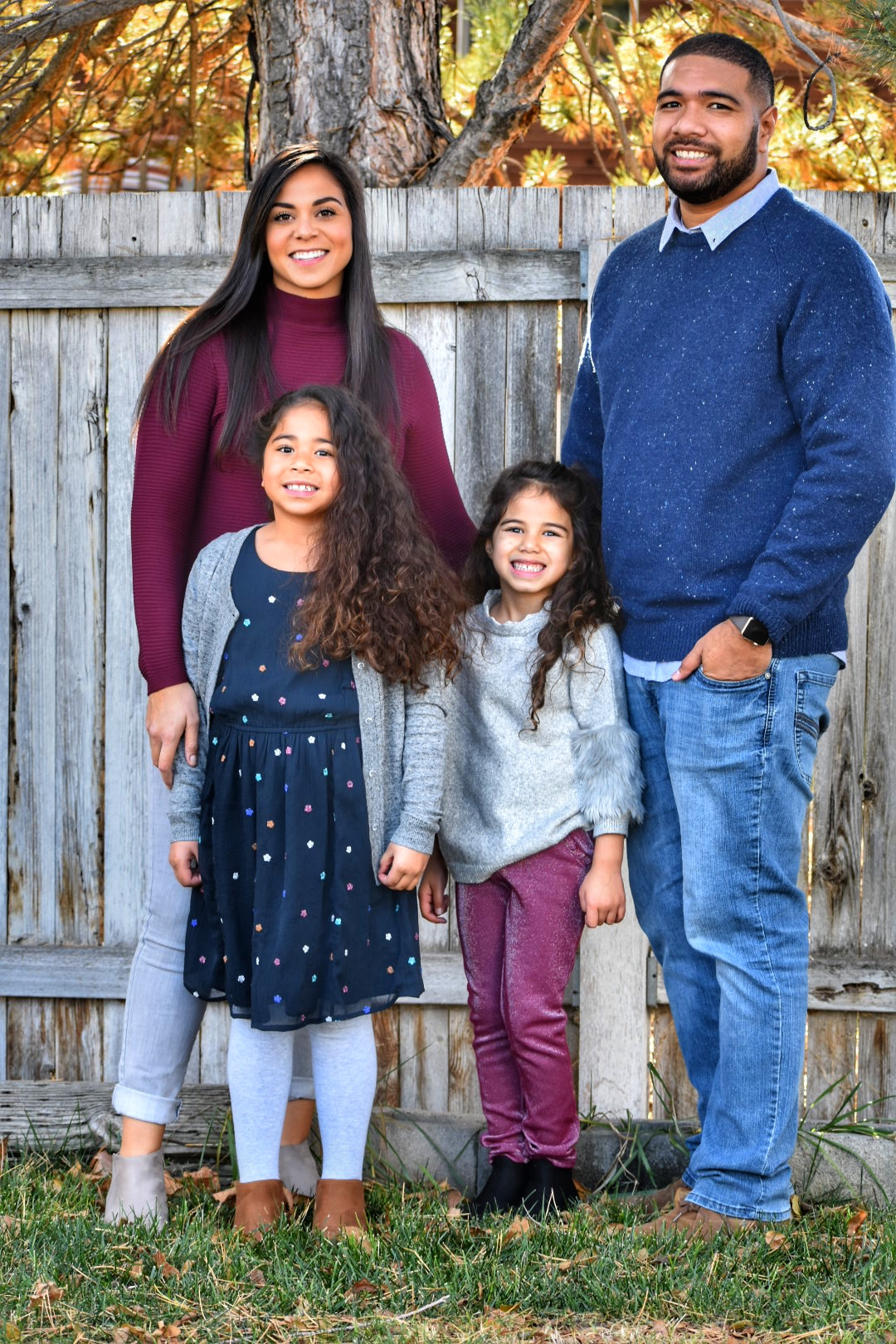 Ikani with his wife and two daughters.