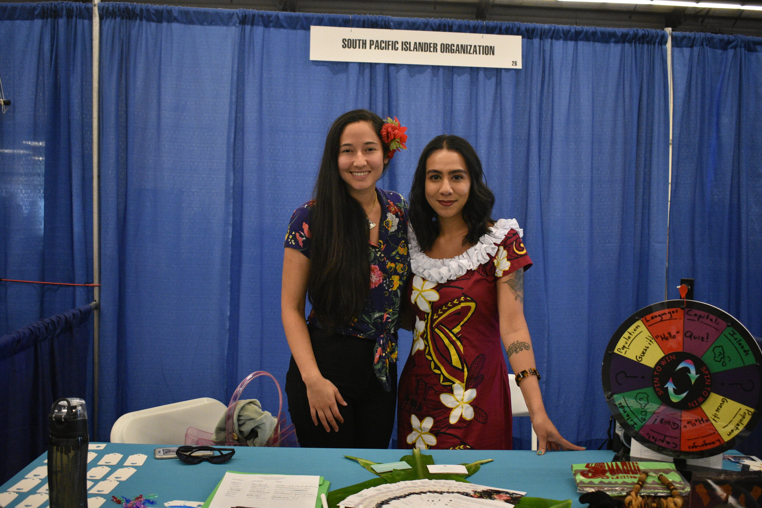 South Pacific Islander Organization (SPIO) board members, Marushka Raimere Hirshon and Seumanu Pou Dimitrijevich, sharing community resources at the 2019 Bay Area Aloha Festival in San Mateo, CA.