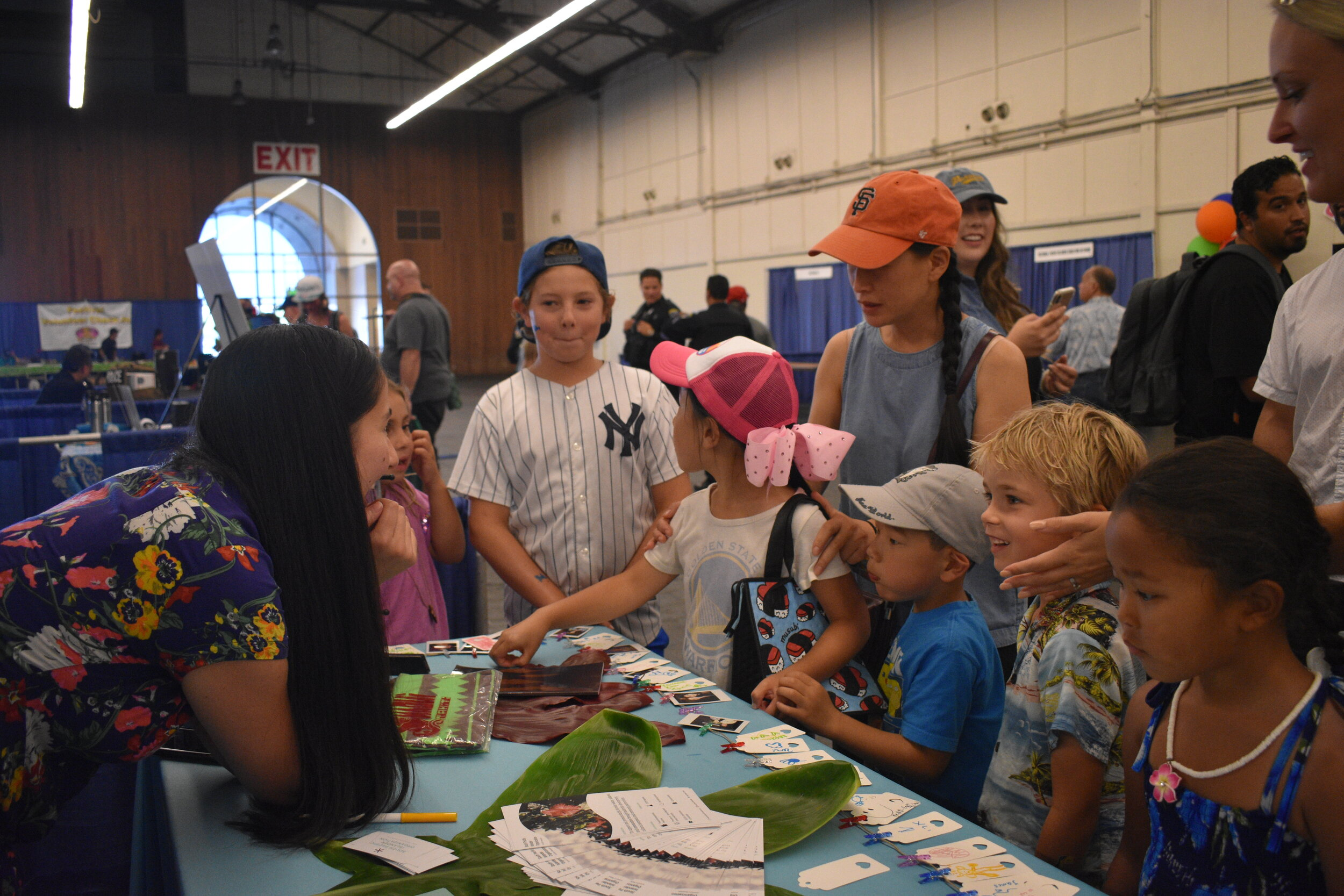 South Pacific Islander Organization sharing community resources with families at the 2019 Bay Area Aloha Festival in San Mateo, CA.