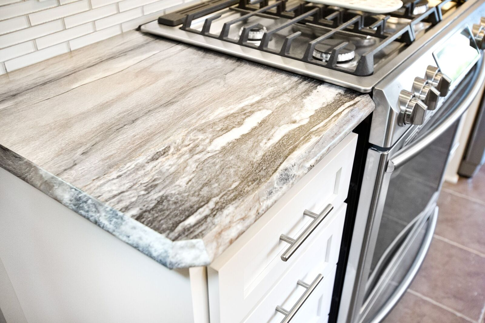 Travertine? Quartz? Nope! Formica Laminte counters. Fooled you too, huh? :)