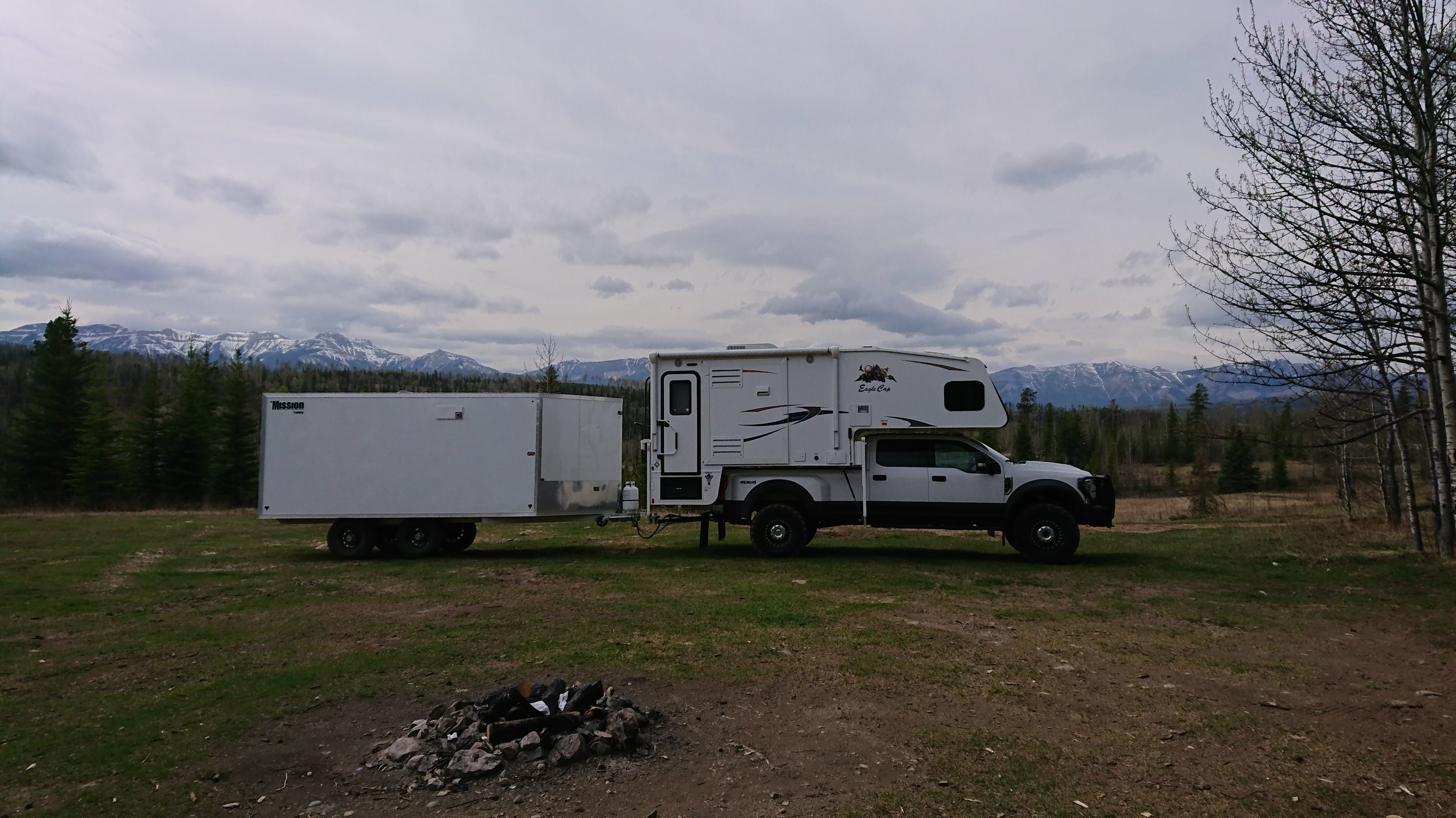 White camper With Trailer