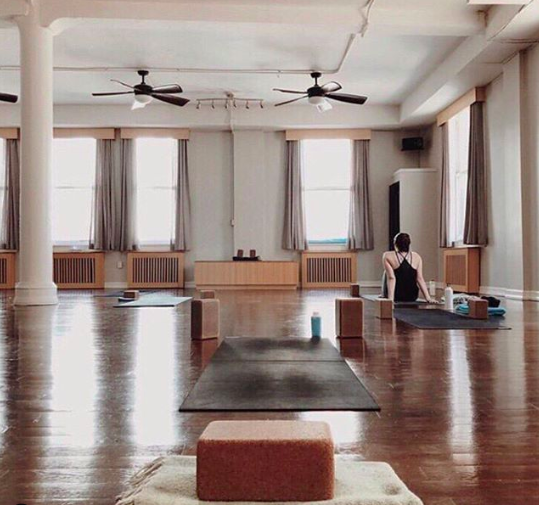 4. YOGA VIDABest for Beginners - Yoga Vida has four beautiful locations in NYC: USQ, NOHO, Tribeca and Dumbo. Each location has multiple studios and hosts classes that range from restorative yin classes to heated power flow classes. The studio is strictly yoga. You won't ever see pilates or sculpt classes on the schedule and the studios always feel like a yoga studio, clean and light. Instructors guide in a safe and effective manner and contribute to the peaceful energy of the studio.Photo @yogavidanyc