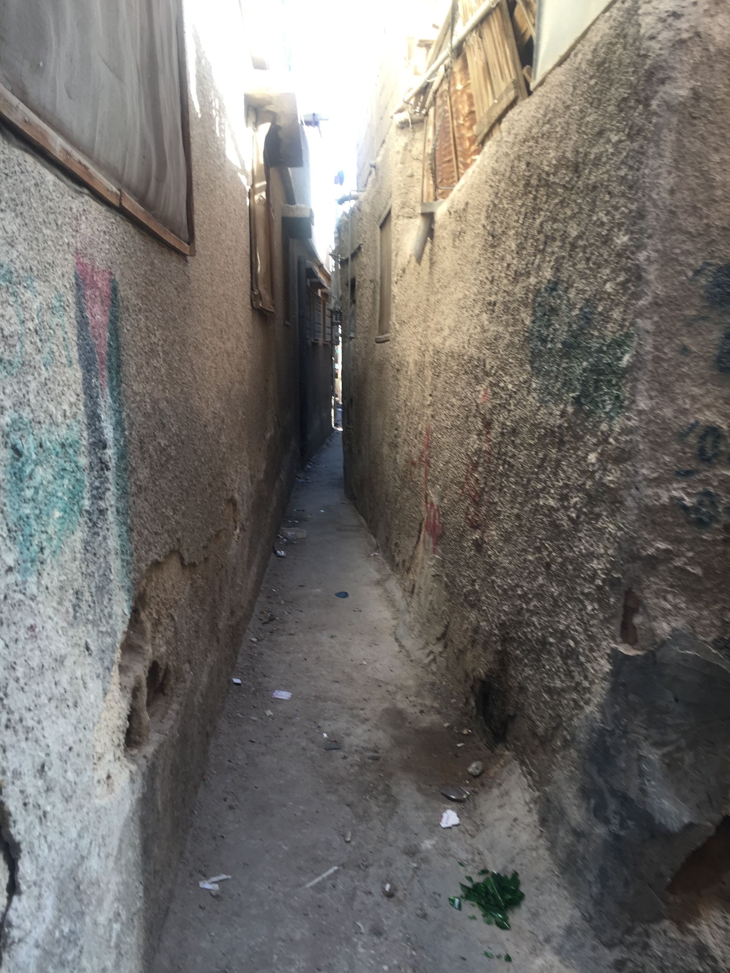 A narrow alley between houses in the Zarqa Refugee Camp, Jordan.