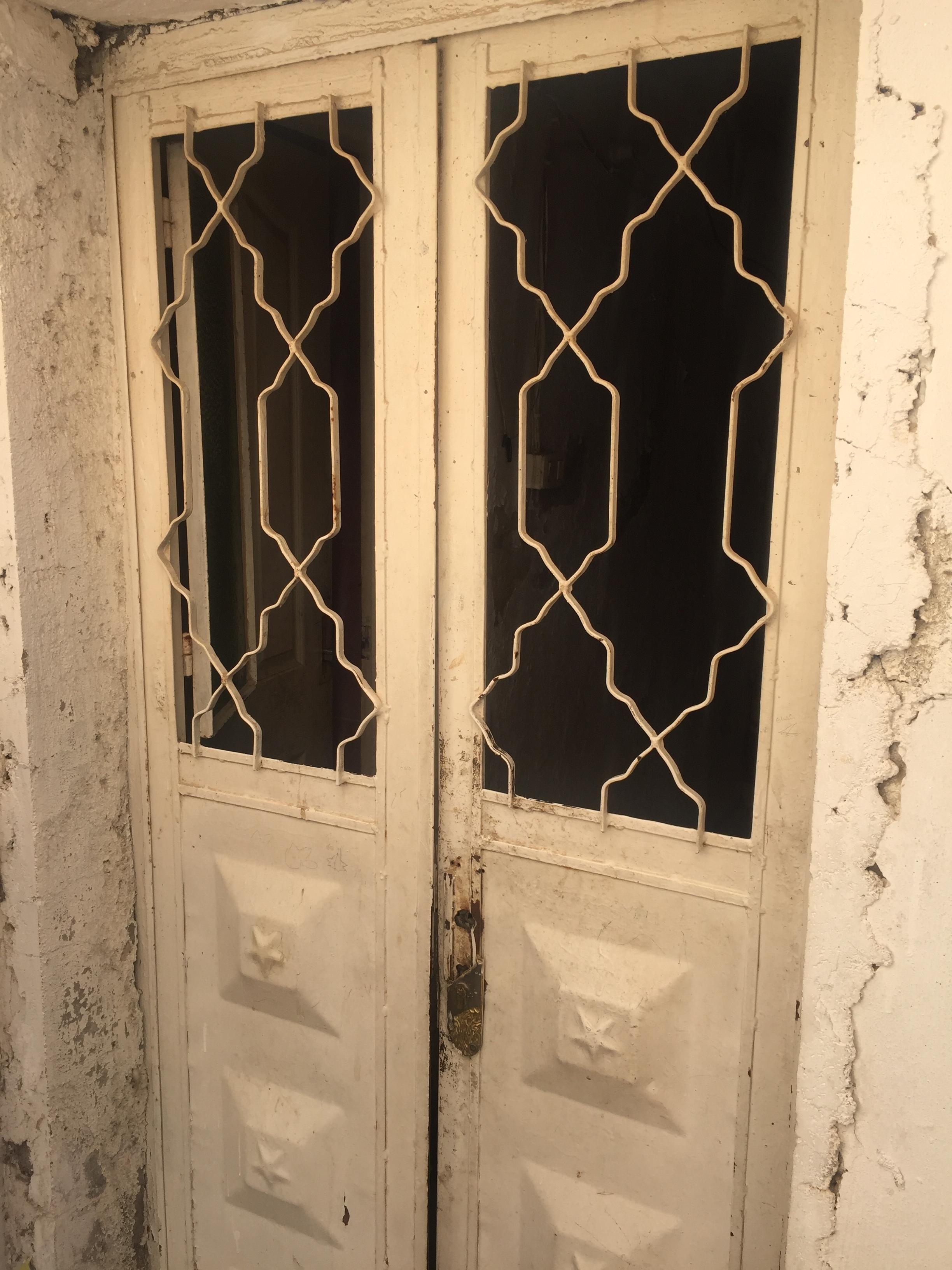 Before - Broken windows and a door that does not lock