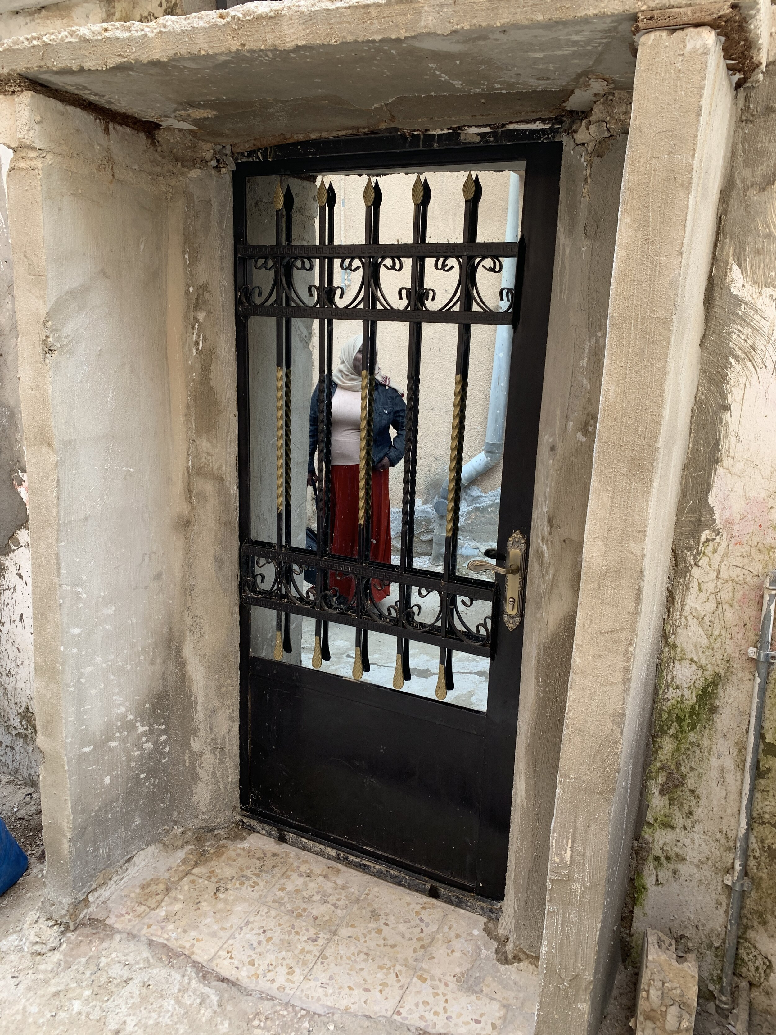 After - A new door with mirror glass and that locks properly!