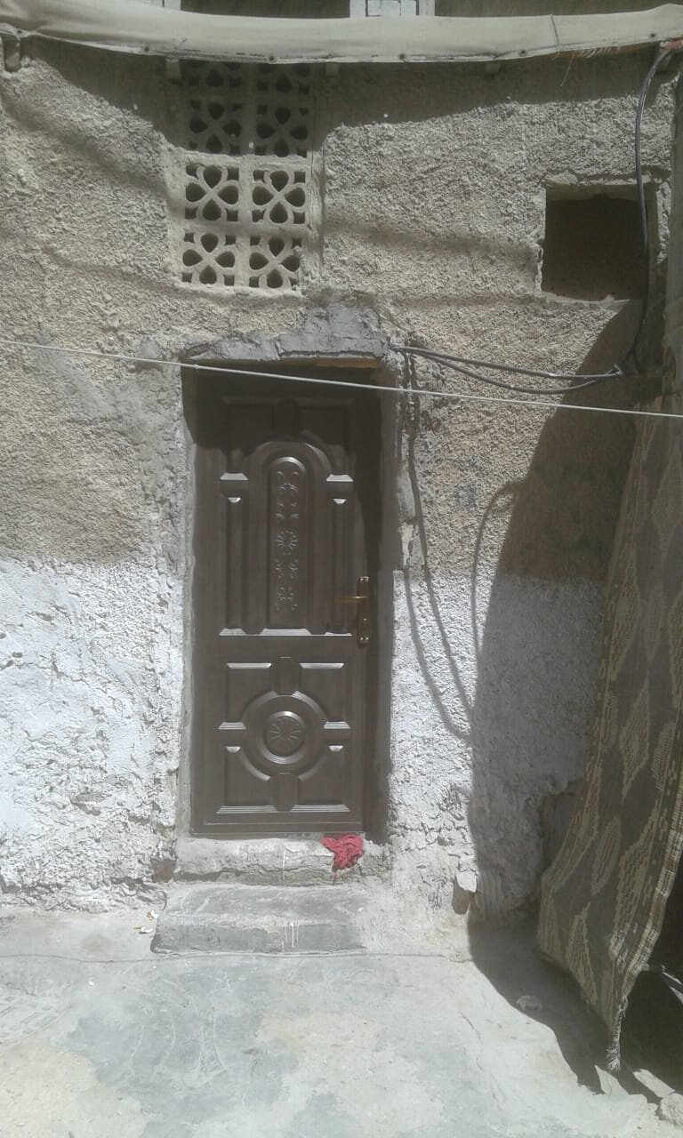After - A steel door that helps Um Ibrahim keep rodents and bugs out