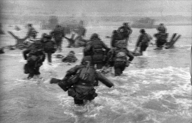 Soldiers storm Omaha Beach in one of Robert Capa's surviving photos of the D-Day invasion of Normandy. (International Center of Photography/Magnum Photos)