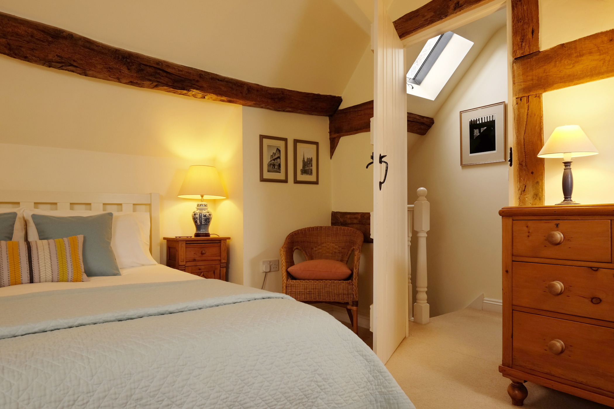 Cottage bedroom and view to landing