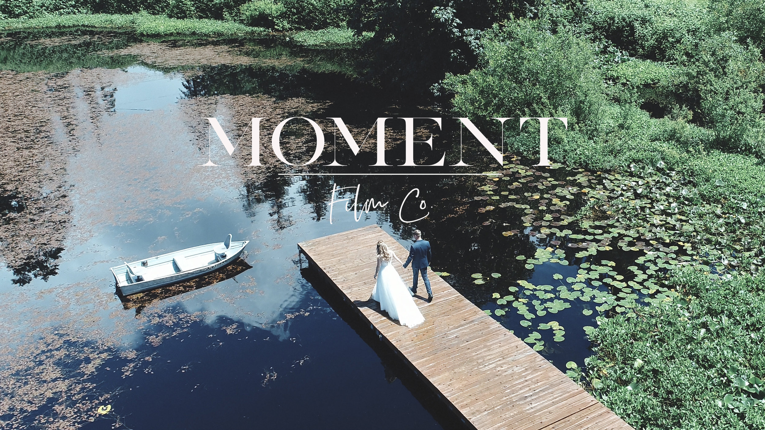 Moment Logo over pond.JPG