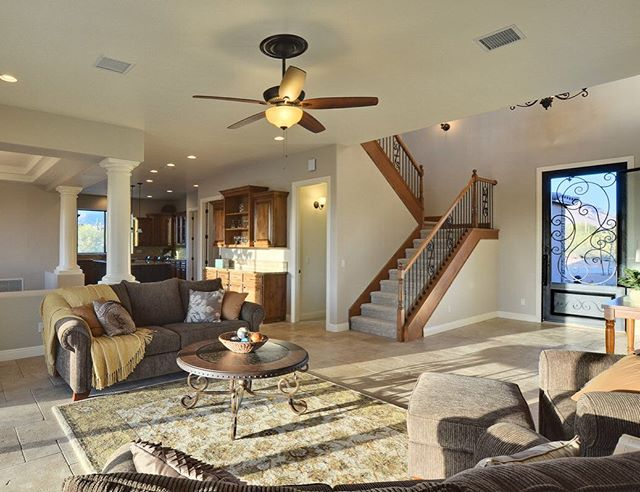 The great room from one of our custom homes. Travertine floors are a lot of maintenance, but they can beautiful.