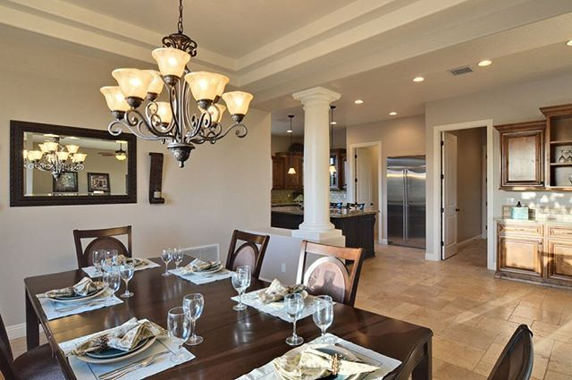 Here is the dining room in one of our custom homes. This home is built in the more traditional Arizona style.