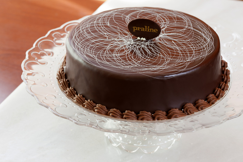 Chocolate Decadence   Rich, light, flourless chocolate almond cake with whipped ganache and covered with dark chocolate glaze  36.00