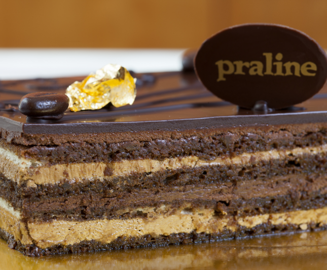 Opéra   Thin layers of almond cake soaked in coffee syrup and layered with chocolate glance and coffee buttercream  41.00