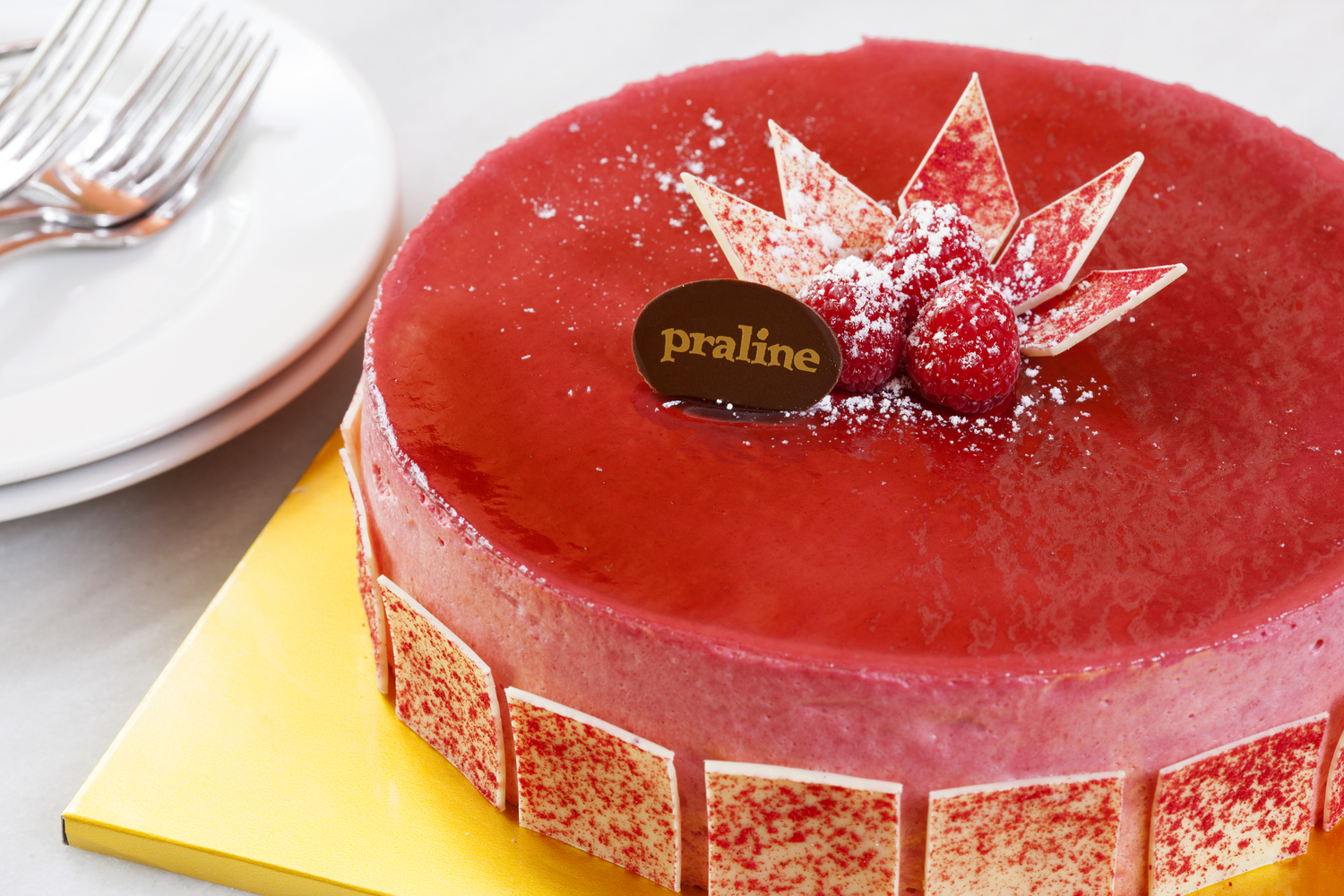 Raspberry Mousse   Chocolate cake topped with sultane cream and fresh berries and covered with raspberry mousse  42.00