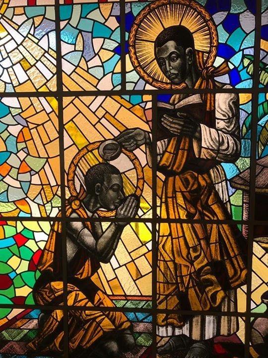 St._Kizito_being_baptised_by_St._Charles_Lwanga_at_Munyonyo.jpg