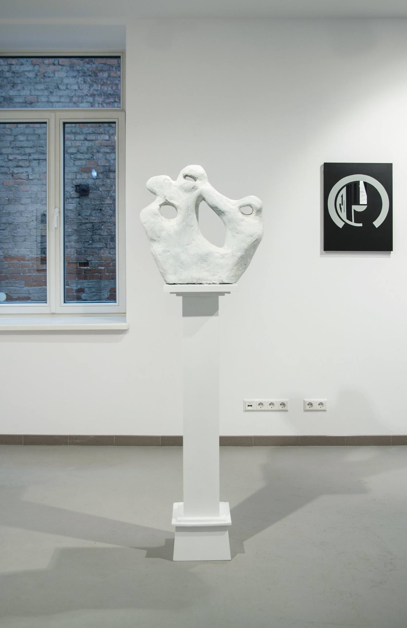 In search of another Laocoon  2016 . Foam, plaster. 180cm x 50cm x 25cm   'In search of another Laocoon'  In this sculpture, Francis uses the hellenistic Greek sculpture 'Laocoon and His Sons' as his primary reference point. Although the original sculpture displays a suffering that is grandiose and heroic, Francis' reinterpretation is stoic and quietly violent. The expressive face of the priest has now fallen away, leaving a hole and the suggestion of a head that has been eroded.