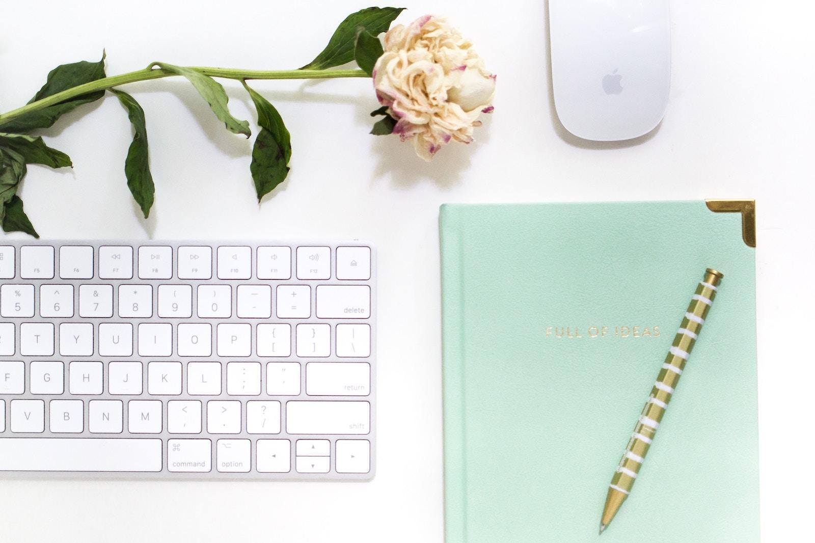 social-media-detox-desk-layout-rose-keyboard-notebook