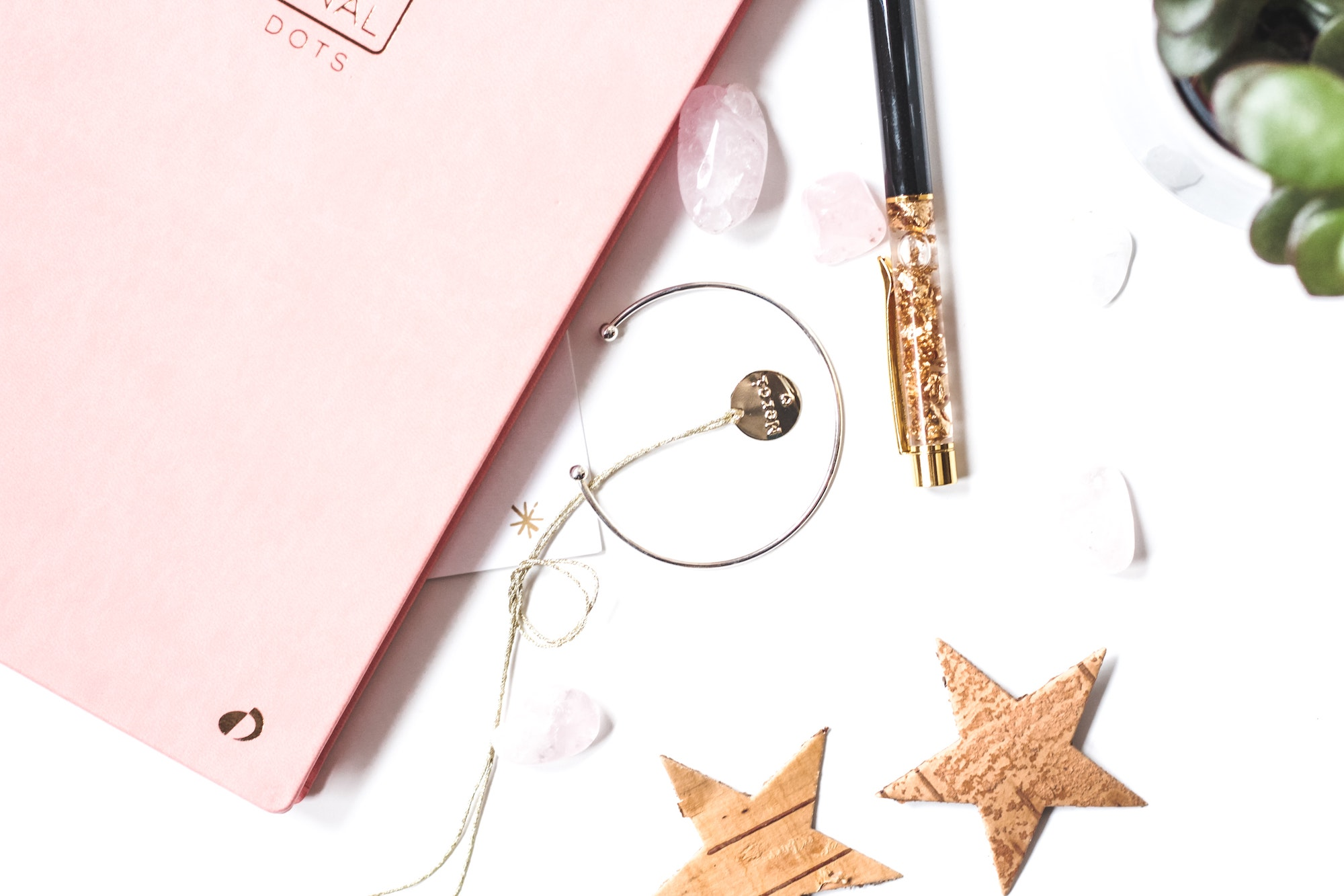 desk-layout-pink-notebook-pen-stars-how-to-pursue-your-dreams