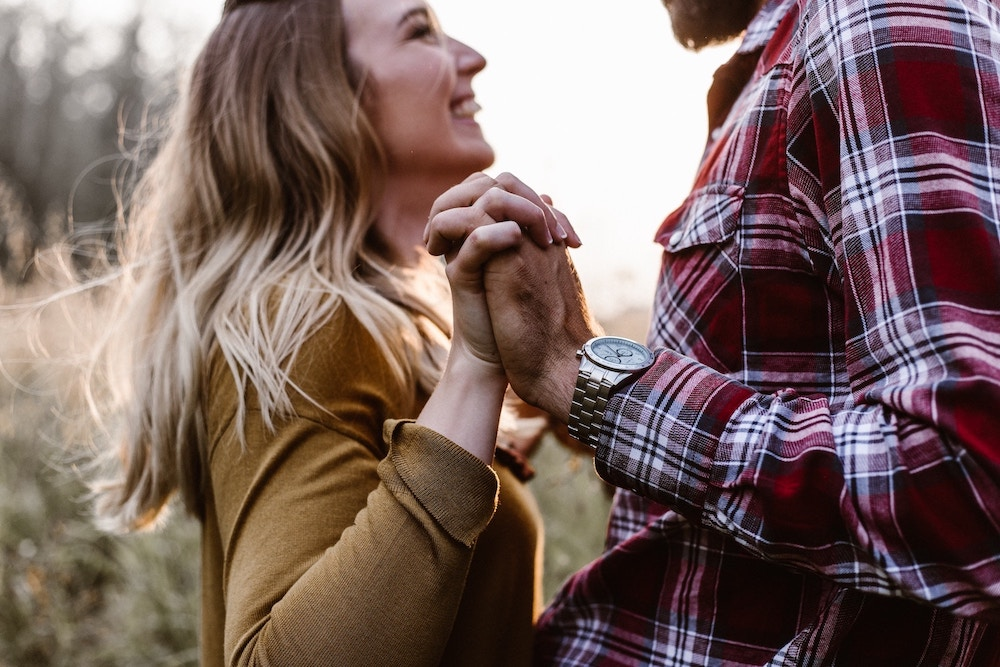 couple-holding-hands-smiling-how-to-build-up-your-relationship