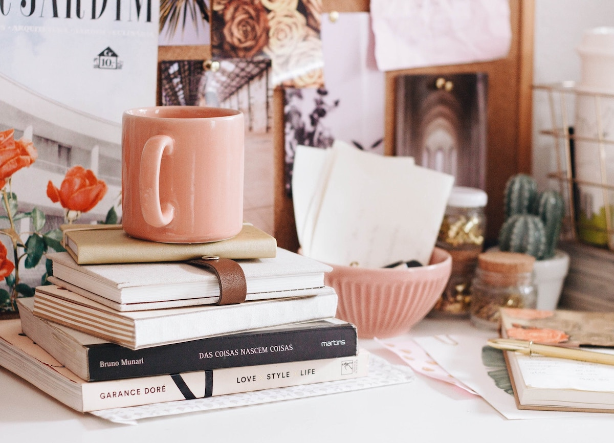 pink-coffee-cup-cluttered-desk