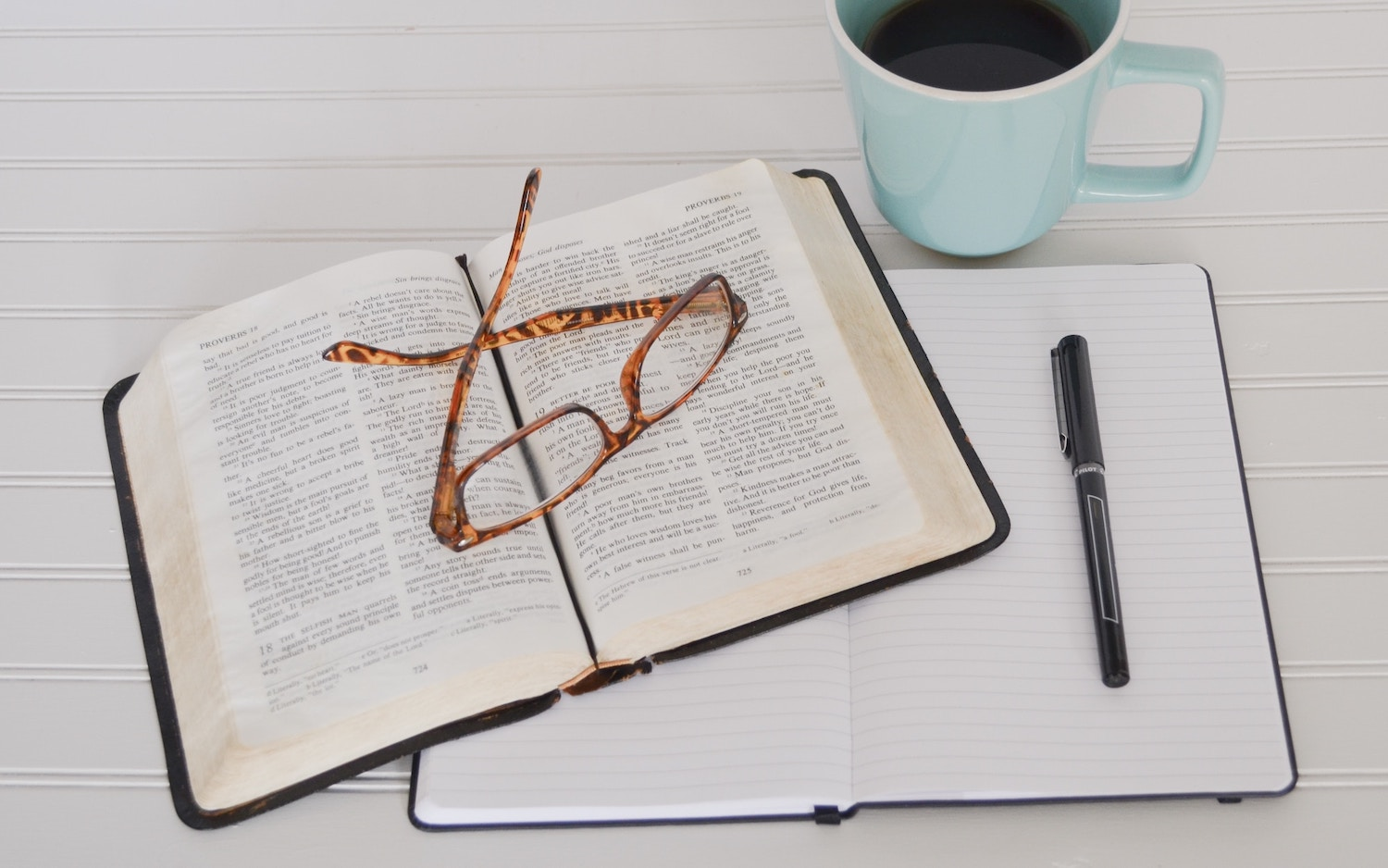 table-layout-bible-reading-glasses-coffee-notebook