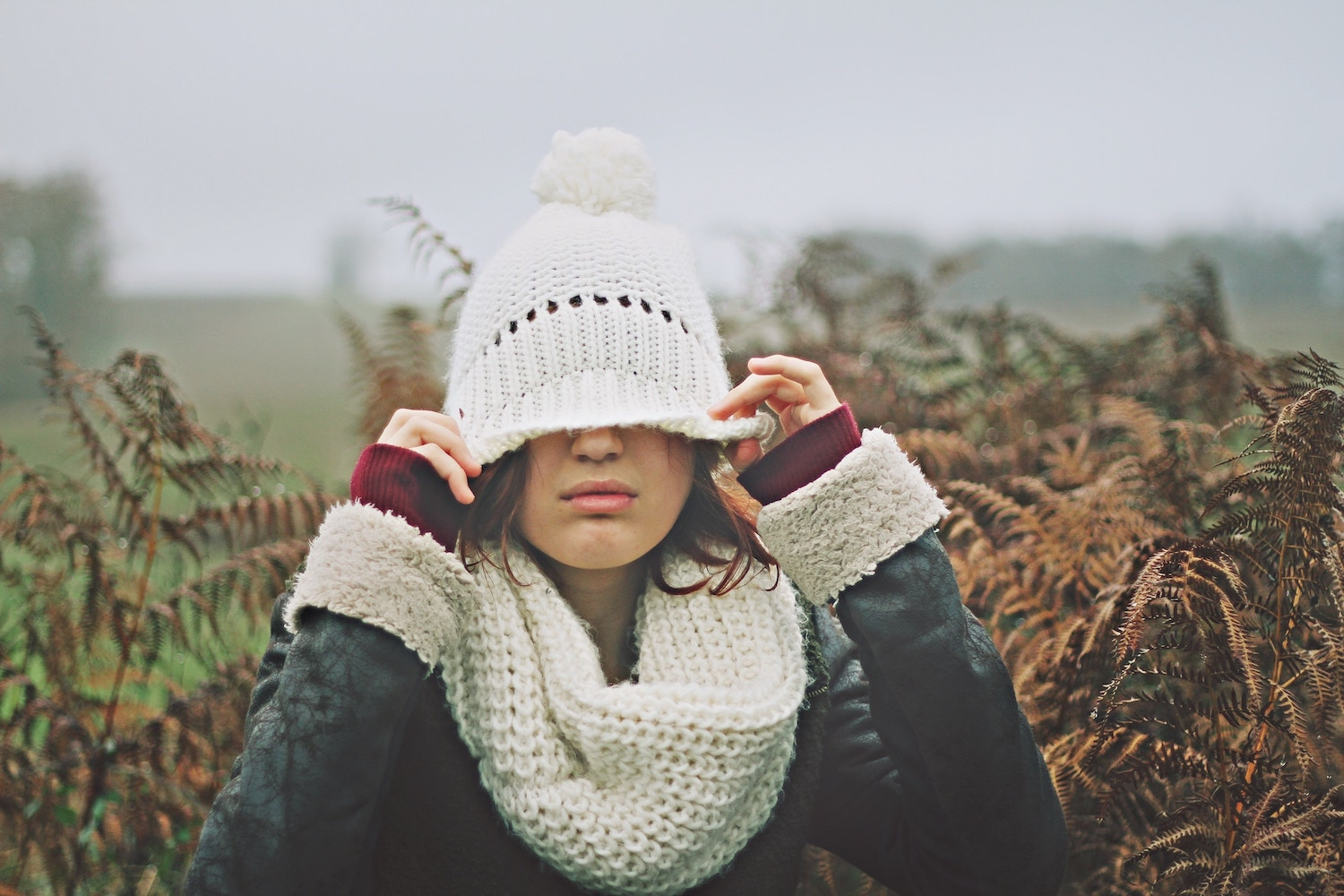 girl-covering-face-knit-cap