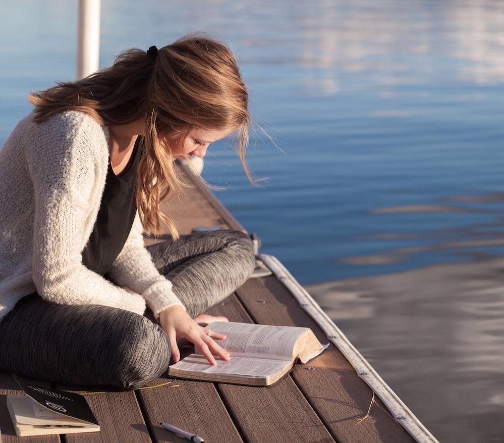 girl-on-dock-reading-bible