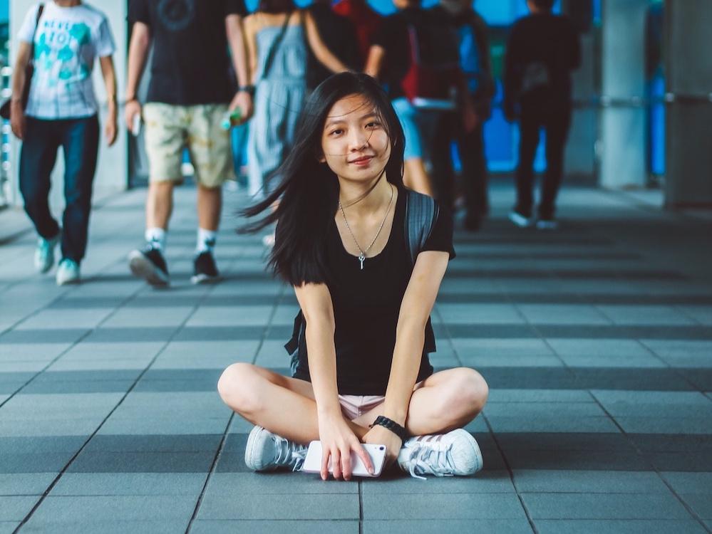 young-girl-sitting-on-hallway-floor