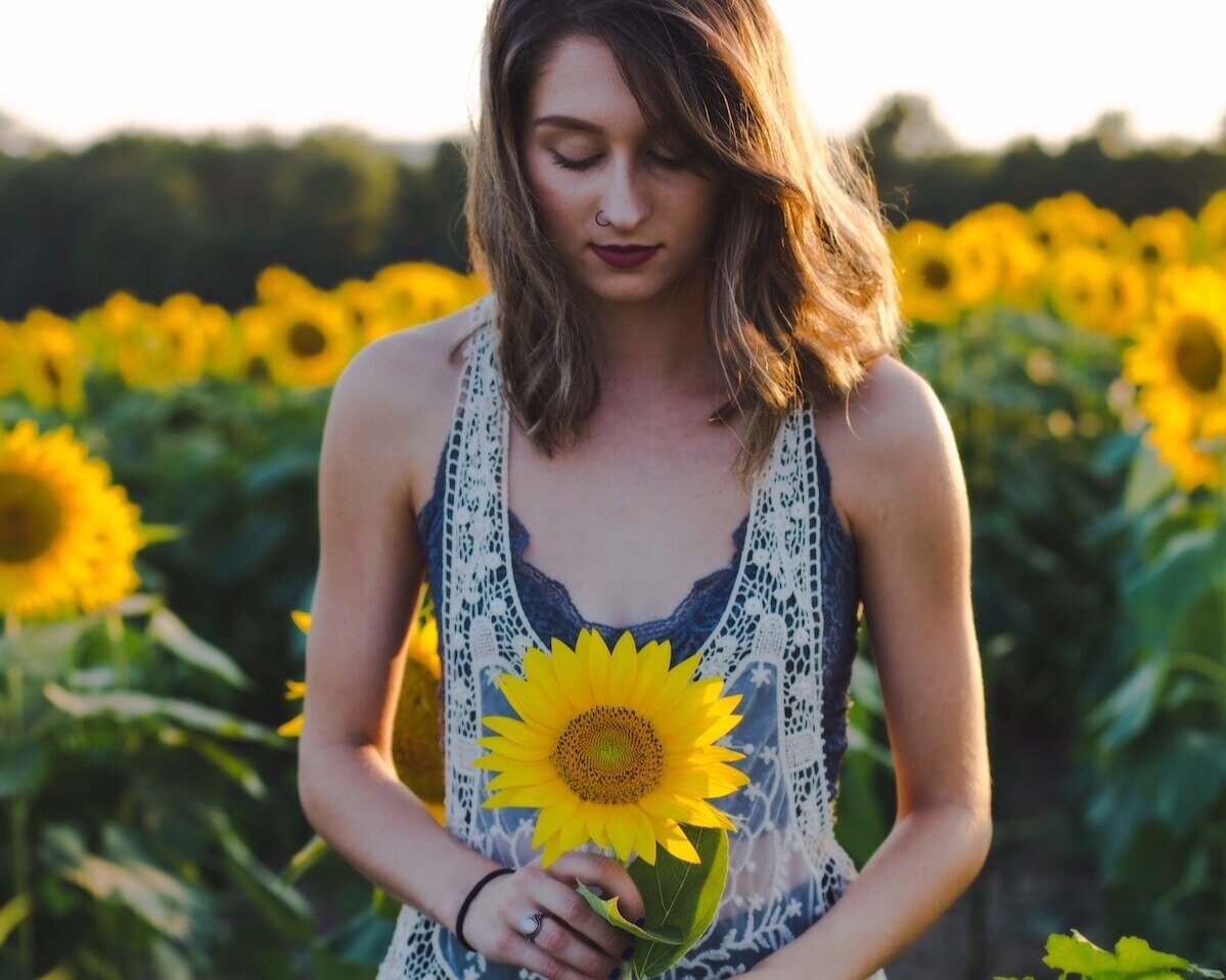 young-girl-holding-sunflower