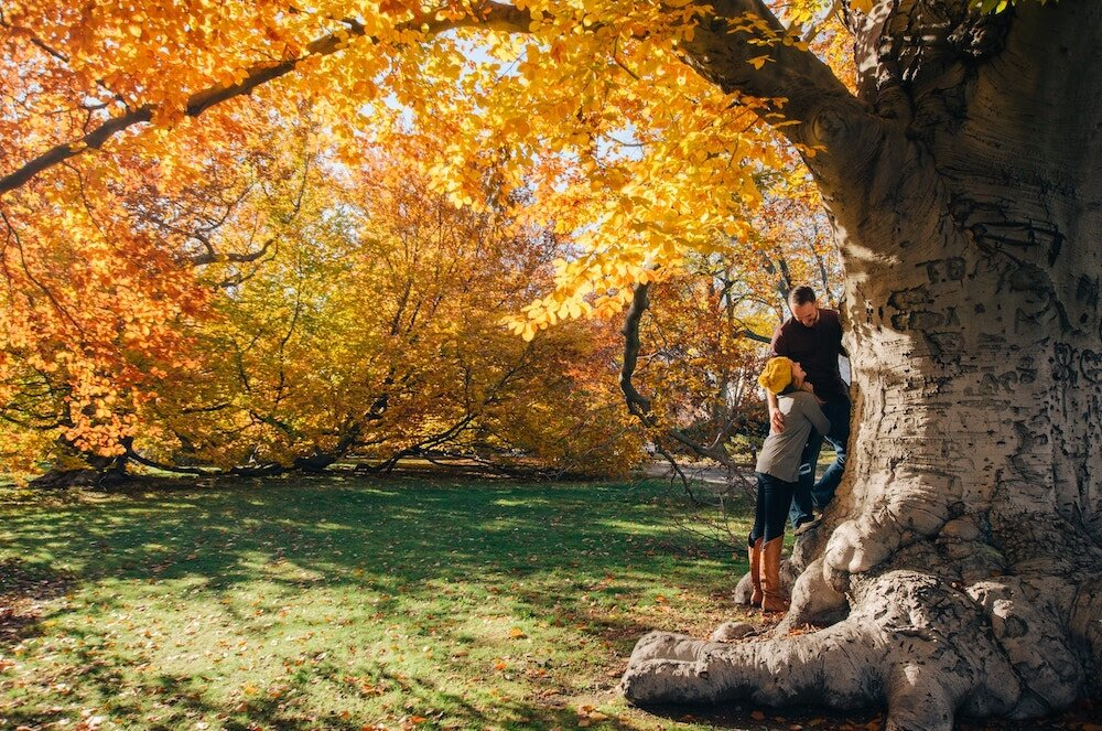 cute-couple-laughing-together-fall-leaves