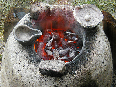 firing some components for casting:  a Ladle, a couple of air flow plugs, cast off bowl.