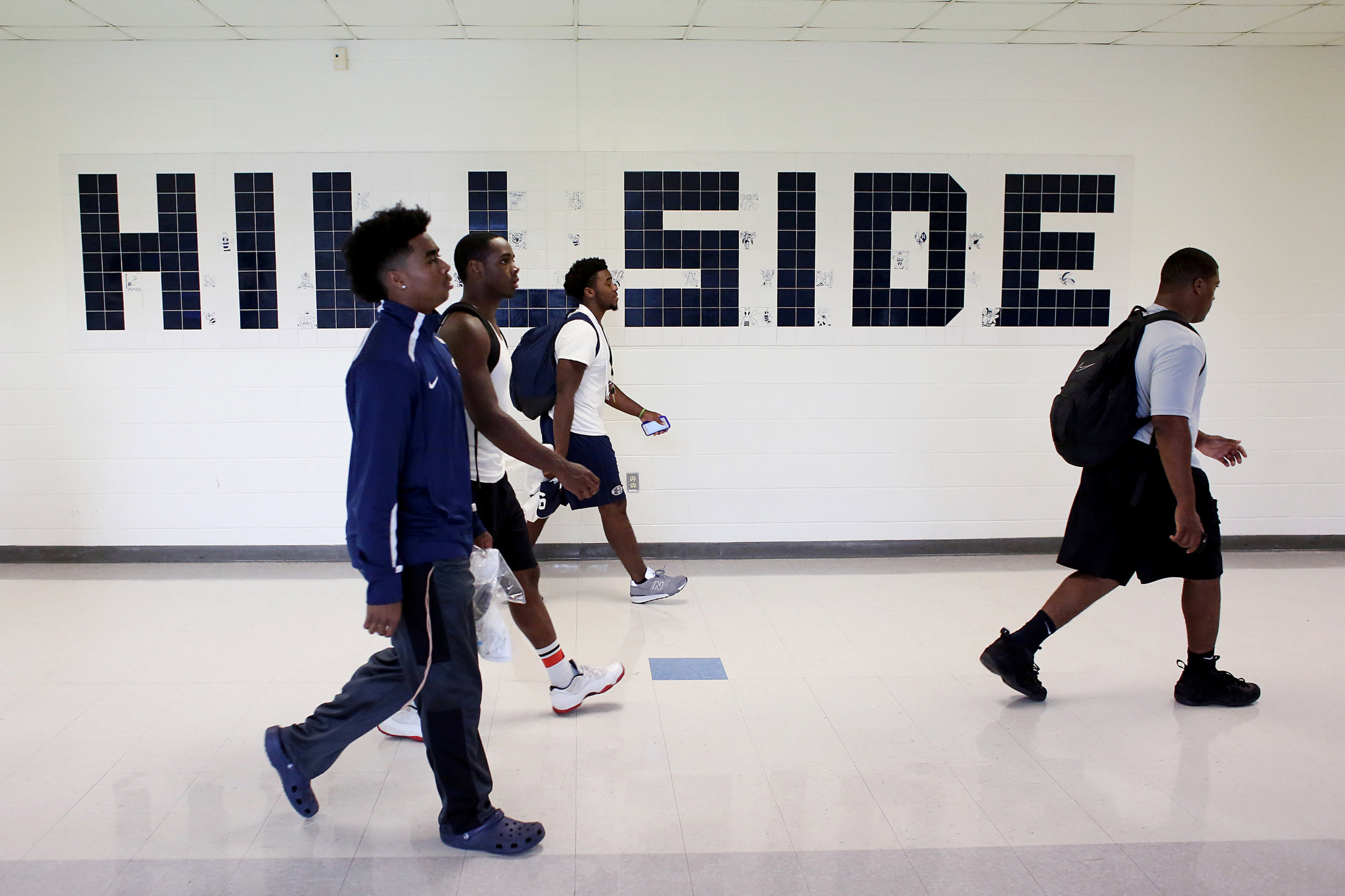 Hillside's Tory Truesdale, from left, Tavis Rhodes, Deion Williams, and Aaron McCullough walk down the hallway of their school, Sept. 15, 2016, prior to watching the the junior varsity football team play.