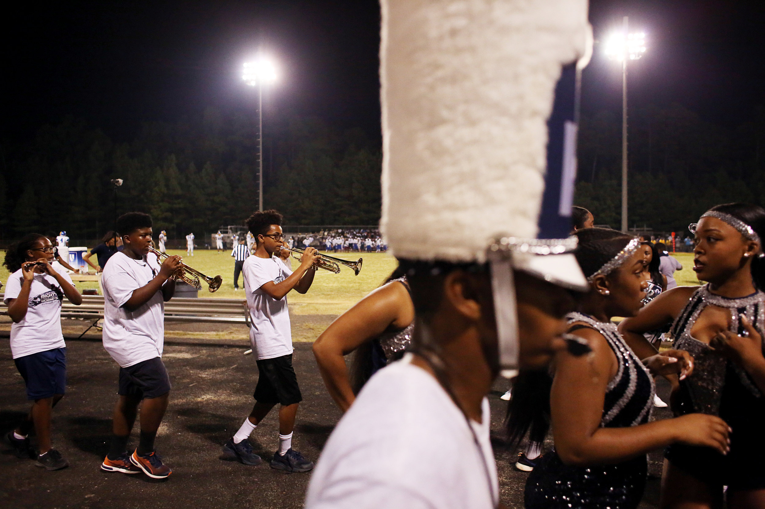 Members of the Hillside High School band and dance team perform during halftime of a football game, September 9, 2016, at Hillside High School.