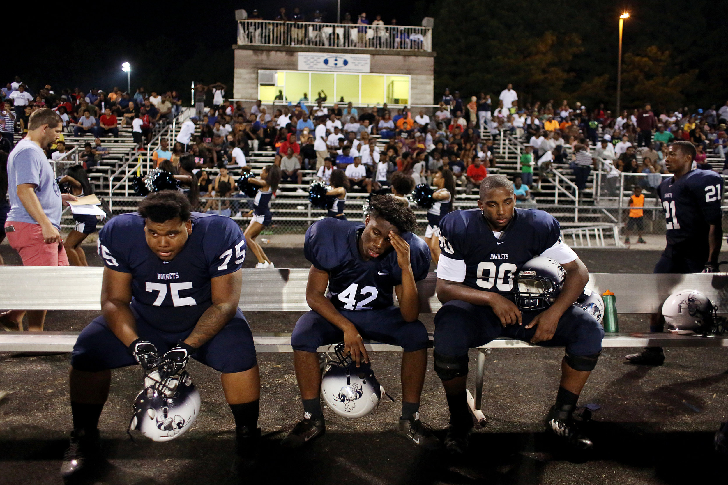 Hillside's Devonta Horton, from left, Saviya Moore, and David Gray sit on their team's bench late game against Dudley High School, Sept. 9, 2016, at Hillside High School. Hillside lost, 32-26, the team's only loss of the regular season.
