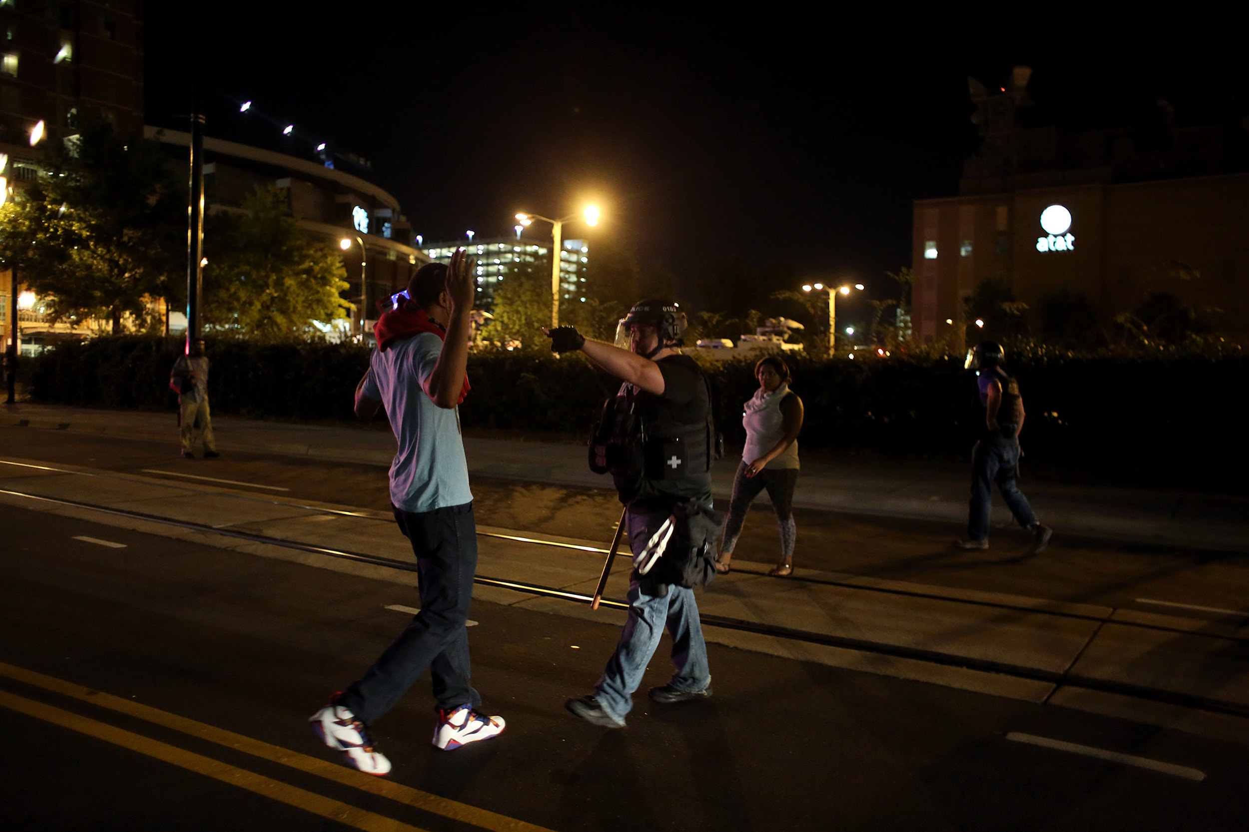 A law enforcement officer commands a protester to get out of the street, Sept. 21, 2016, on East Trade Street in downtown Charlotte, North Carolina.