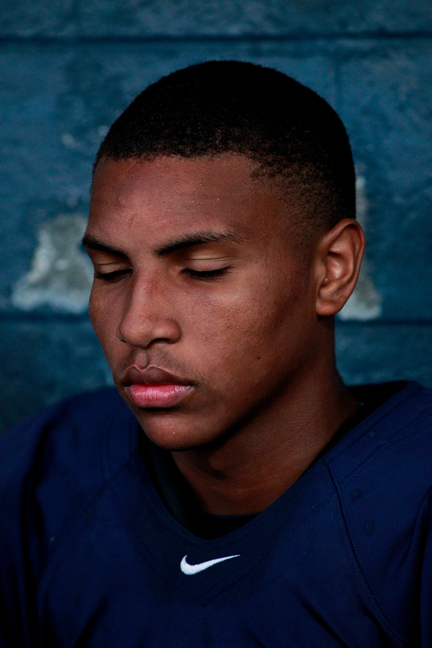Hillside High School quarterback Randy Trice Jr. pauses during halftime of a game against Southern High School on Monday night, Sept. 5, 2016, at Hillside High School in Durham, N.C. Hillside won, 7-3.