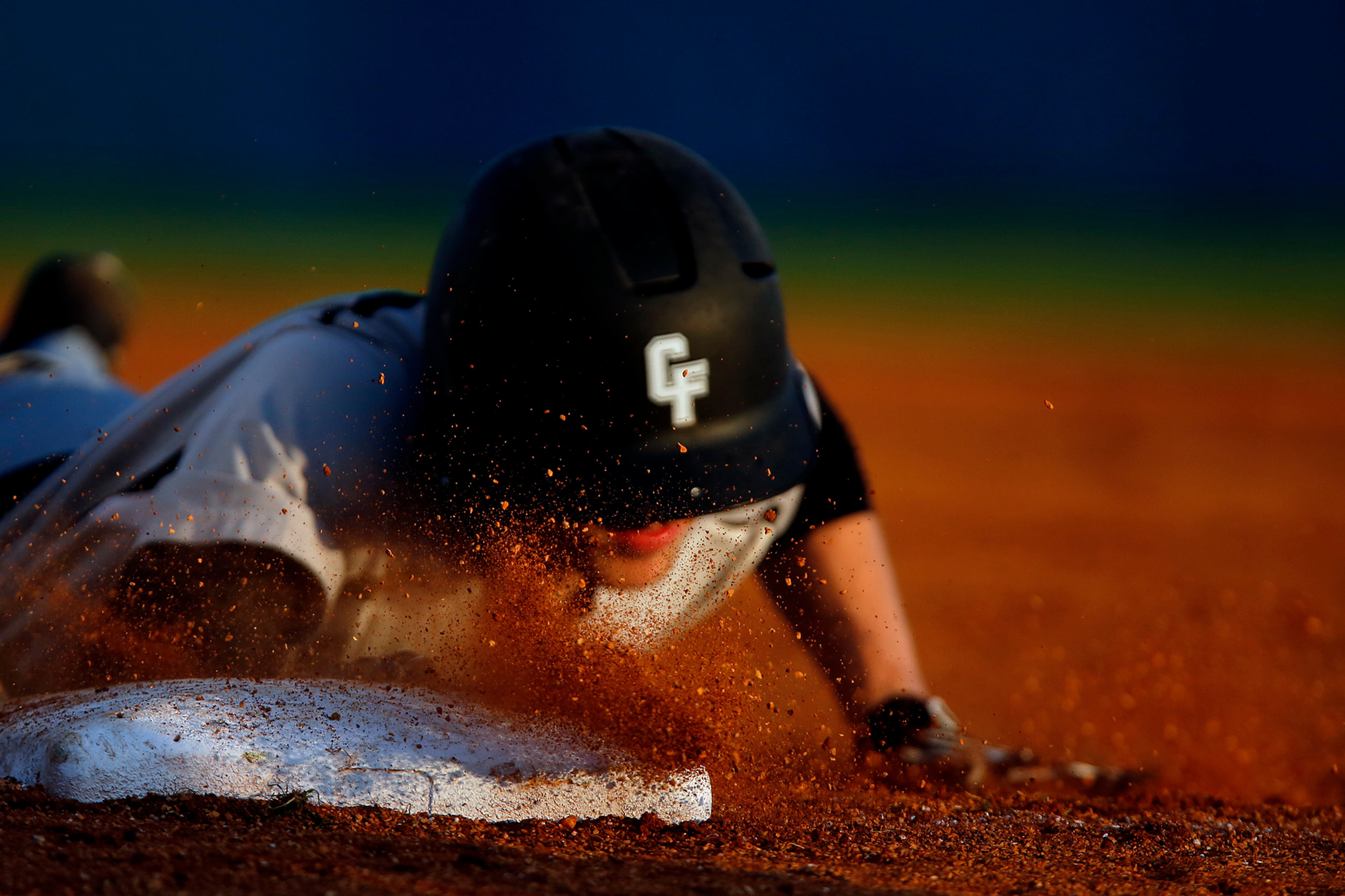 Carolina Forest High School's Brendan Calvert dives back to first base as his team took on South Florence High School on Tuesday, April 21, 2015, at South Florence High School. Carolina Forest won, 14-1.