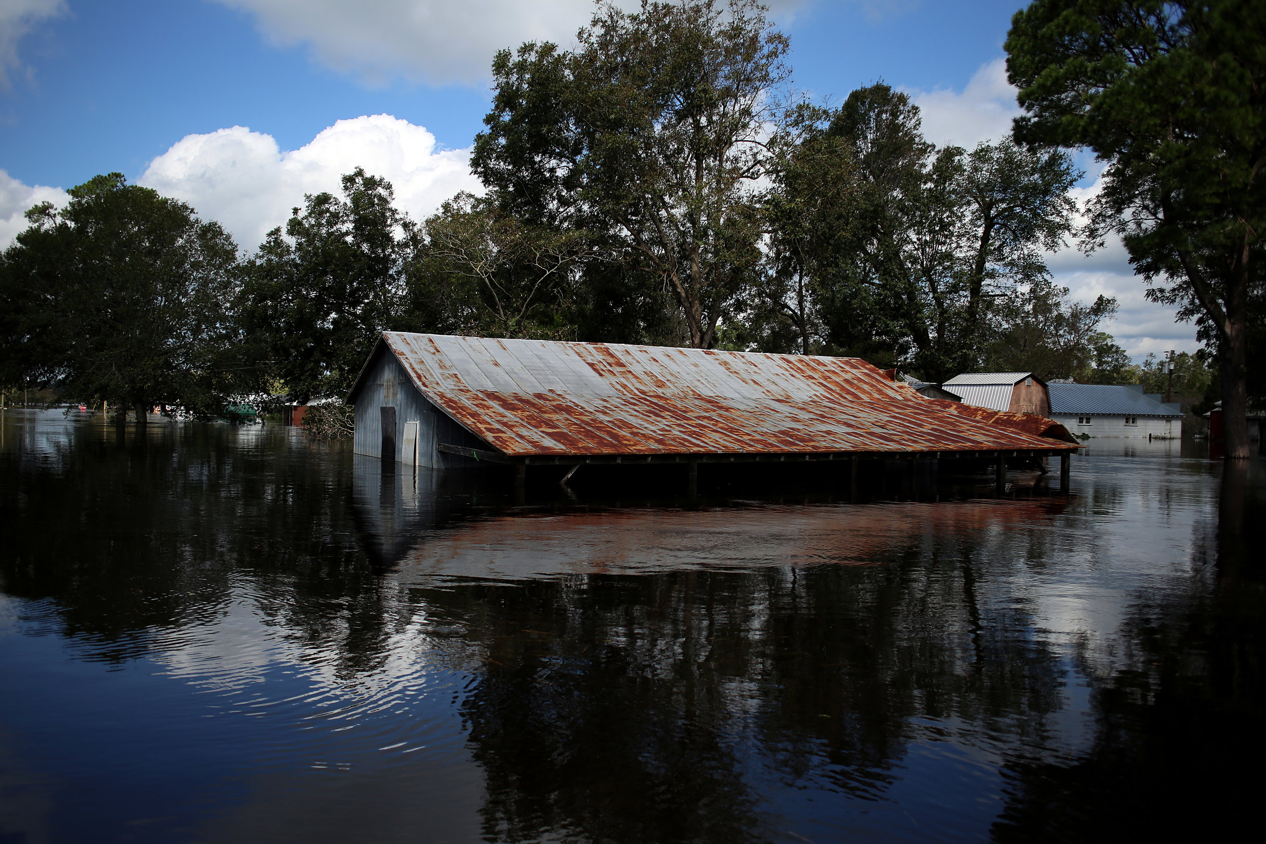 A structure flooded by the nearby Trent River is seen Sept. 18, 2018, in Pollocksville, N.C.