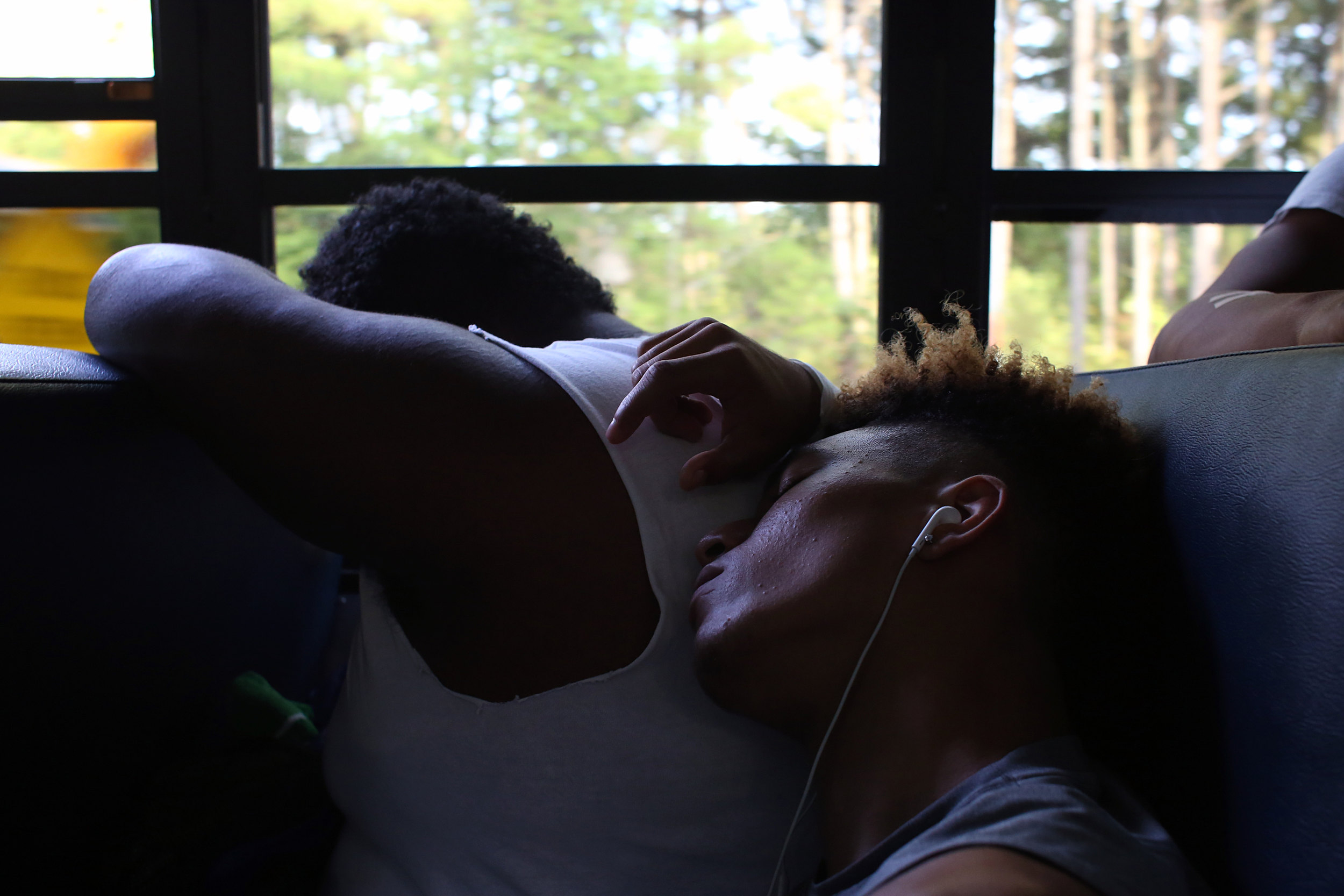 Hillside's Corey Spell, right, uses a teammate as a pillow during a September 16, 2016, bus ride to South Boston, Va. to play Halifax County High School.
