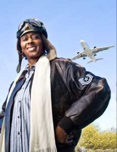 """Bessie Coleman PORTRAYED BY DAISY CENTURY  - The first African-American woman to become a licensed airplane pilot and the first American to hold an international pilot license, Bessie Coleman was a woman who didn't give up. Born in Texas, raised on a farm, she loved school and walked four miles every day to attend a one-room all-black school through 8th grade. Working with her mother and two sisters, she did laundry, cleaned homes, picked cotton to earn money to finish school. At age 18, she enrolled in the Oklahoma Colored Agricultural Normal University, but only had enough money for one year. Traveling north to Chicago to live with her brothers, she heard stories from pilots returning from World War I and decided to become a pilot. After applying to 3 American aviation schools that refused to teach her, this smart, naturally-gifted """"double threat"""" prepared to study in France. Learning enough French to get by, she enrolled in a French school, the only black person in the class. Finishing the 10-month course in 8 months, she achieved her goal.Dressed in an authentic bomber's jacket, boots and scarf, Dr. Daisy Century as Bessie Coleman is an exciting portrayal of a beautiful, determined woman who knew what she wanted and made it happen. Audience members thrill to tales of barnstorming and stunts with parachutes. Bessie inspires the audience to identify with a woman who risked everything to make her dream a reality. Performed as if standing on a wing of the plane, Bessie is a woman who never gave up, raised by a mother who told her that """"these words don't live here."""" Daisy brings a pattern for the younger audience members to use to create their own plane. And she showcases a life that broke the mold, inspiring her audience to do the same.Invite Bessie Coleman your event:•Educational Programs: Program with Press Conference for Schools, Libraries, Museums and Historic Sites •Pair with Amelia Earhart, Charles Lindbergh •Daisy Century: Bio of Actor/Historian, Reenactor"""