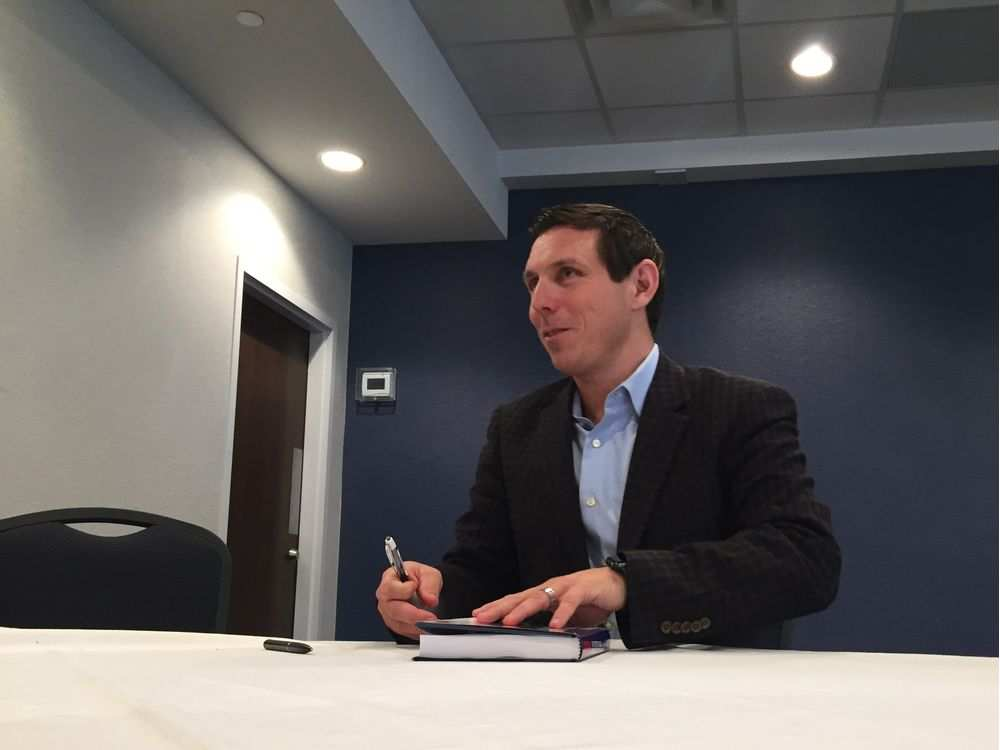 In Ottawa, signing book for admirer