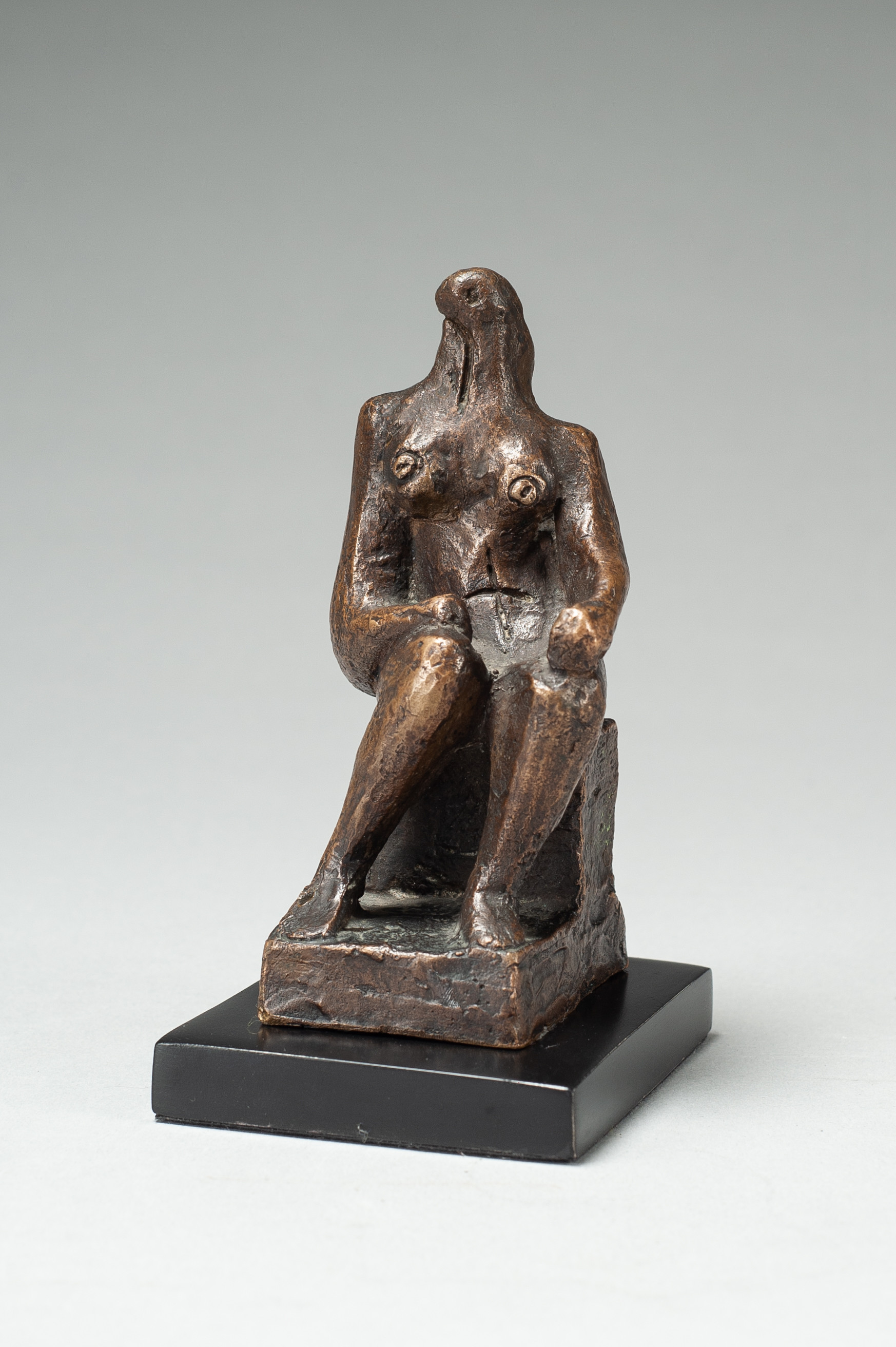 Henry Moore (1898-1986)   Small Seated Figure,  Bronze with brown patina, 13.3 cm, Edition of 7 plus 1 artist's proof