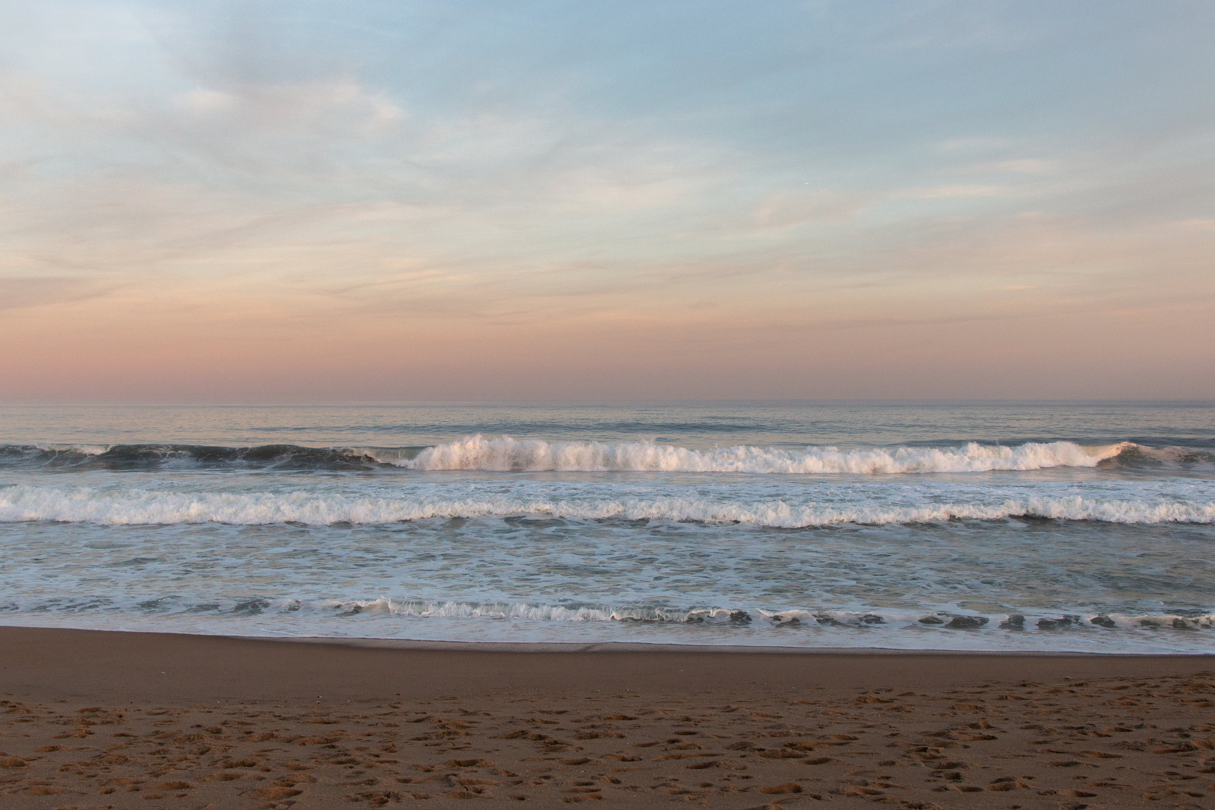 Beach at sunset in Asbury Park, New Jersey. Photo by Kayleigh Ann Archbold.