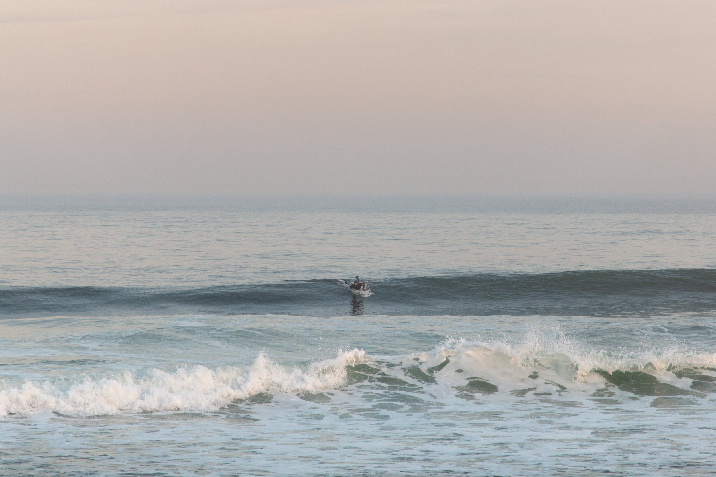 surfer in Asbury Park, New Jersey. Photo by Kayleigh Ann Archbold.