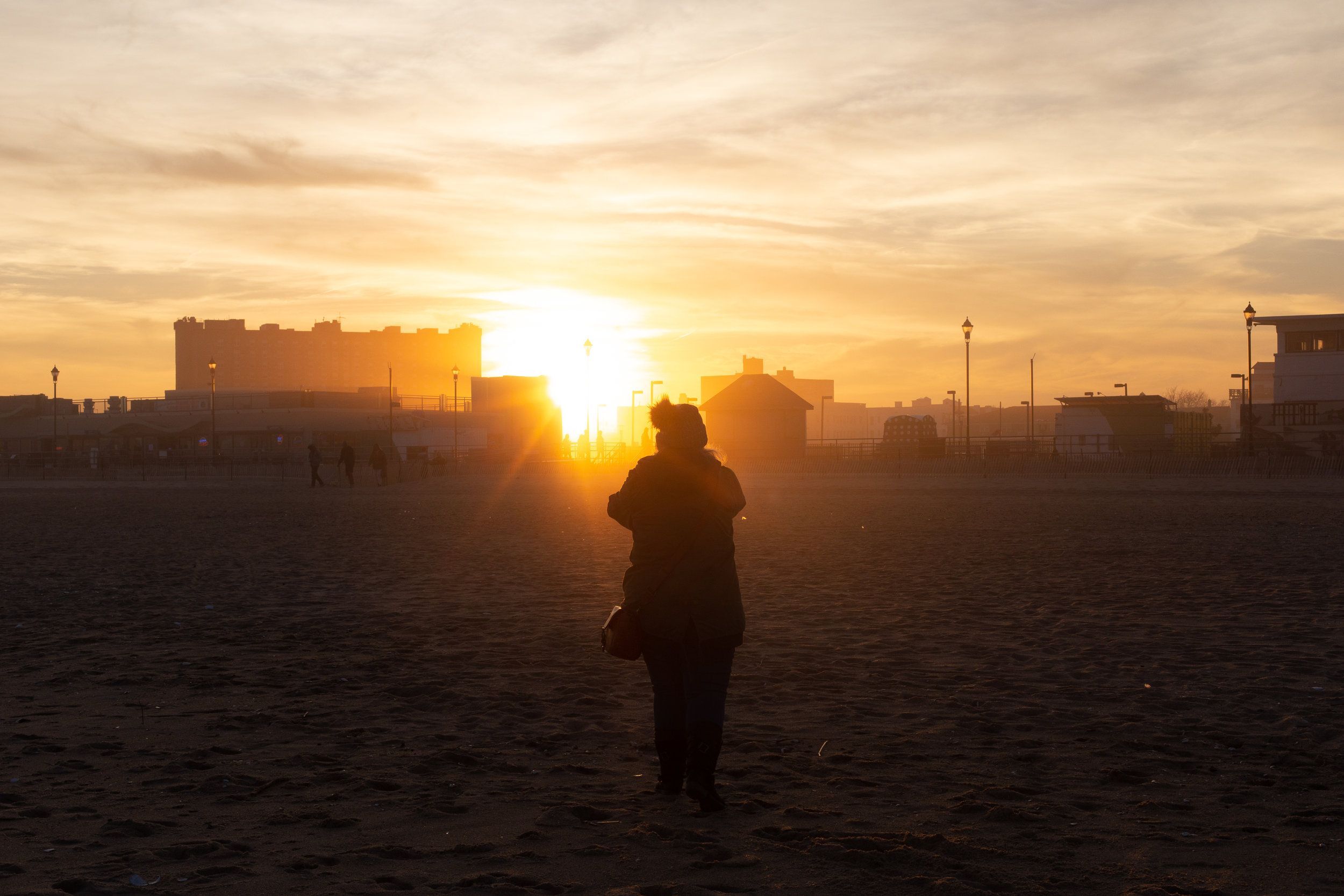 Woman on beach at sunset in Asbury Park, New Jersey. Photo by Kayleigh Ann Archbold.