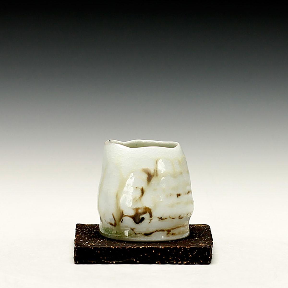 8. Sandy Lockwood - Porcelain pourer on black sw tile - woodfired and salt glazed.jpg