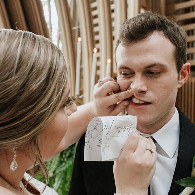 True love is getting things out of your spouse's teeth, even if it means you have to use your wedding program. 😂 If you want to see the emotional and artsy photos, check out the blog post. Link is in the bio, as always!