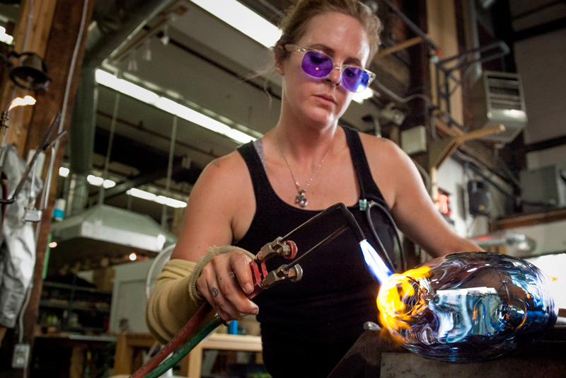 Tara using a hand torch to selectively heat a piece. Photo credit: Terminal City Glass Co-op